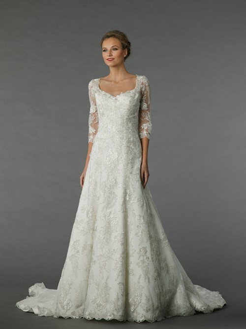 An embroidered lace A-line dress by Alita Graham